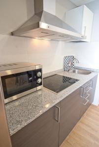 A kitchen or kitchenette at Apartahotel & Spa Jacetania