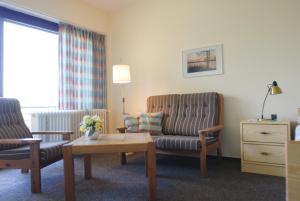 Ein Sitzbereich in der Unterkunft Ferienhaus Uklei