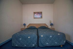 Un ou plusieurs lits dans un hébergement de l'établissement Hôtel de La Poste