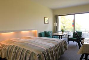 Ein Bett oder Betten in einem Zimmer der Unterkunft Ferienhaus Uklei