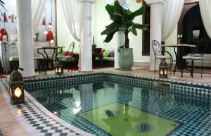 The swimming pool at or near Riad Alida