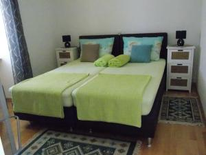 A bed or beds in a room at Haus Božica
