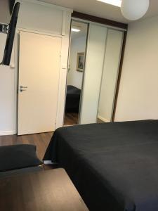Vuode tai vuoteita majoituspaikassa Hotelli Mäntylinna