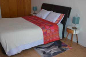 Uma cama ou camas num quarto em Hostel D'Avenida