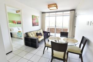 Uma área de estar em Gran Lençóis Flat Residence