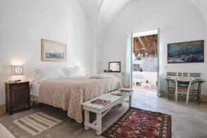 A bed or beds in a room at Masseria Palombara Resort & SPA Adults only
