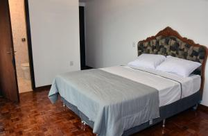 A bed or beds in a room at Muito espaco no Moinhos