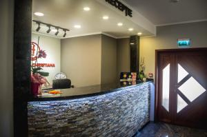 The lobby or reception area at Pensiunea Christiana