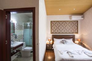 Ванная комната в Hotel Garden House