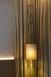 A television and/or entertainment centre at Ascott Orchard Singapore (SG Clean, Staycation Approved)