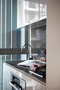 A kitchen or kitchenette at Ascott Orchard Singapore (SG Clean, Staycation Approved)