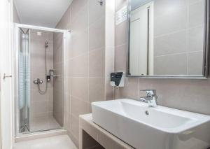 A bathroom at Diogenis Hotel
