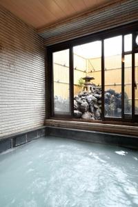 The swimming pool at or near Ryokan Tamura