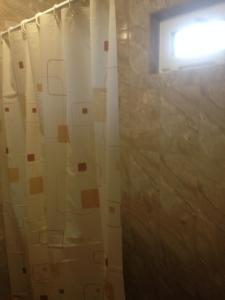 Ванная комната в Guest House Belaya Lebed