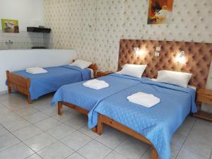 Кровать или кровати в номере Hotel Apollon