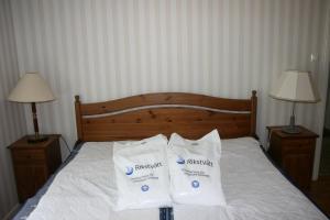 Säng eller sängar i ett rum på Borggården Apartment