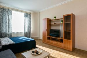 A bed or beds in a room at Rentlis центр Щелково