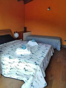 Letto o letti in una camera di B&B Villa Claudia