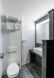 Ванная комната в Bastion Hotel Almere