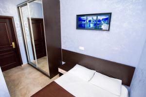 Кровать или кровати в номере Отель Космос у Аквапарка