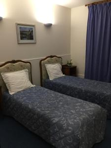 A bed or beds in a room at Hotel De Clagny