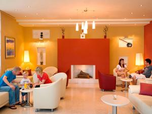 A restaurant or other place to eat at Allegro Sunny Hotel by Valamar