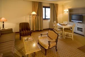 A seating area at Real Residência - Apartamentos Turísticos