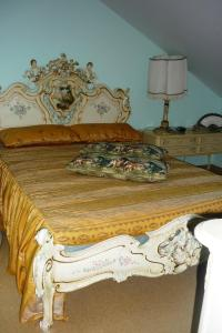 A bed or beds in a room at Klaipeda-Apartments