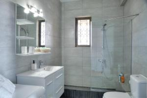 A bathroom at Athens Glyfada Riviera Apartment