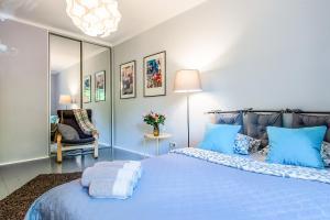 Łóżko lub łóżka w pokoju w obiekcie Muranow Warsaw Apartment