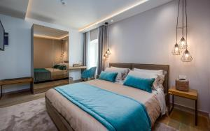 A bed or beds in a room at Relais and Wine San Tommaso