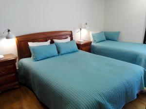 A bed or beds in a room at Vila Real Loft 360º
