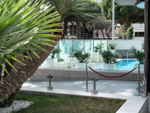 The swimming pool at or near Club House Hotel