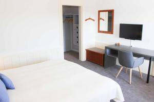 En eller flere senge i et værelse på Griffen Spa Hotel