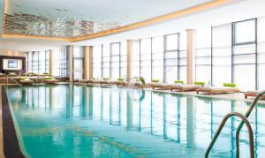 The swimming pool at or near Renaissance Minsk Hotel