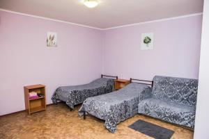Кровать или кровати в номере Гостевой Дом Альтаир