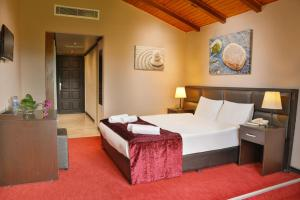 A bed or beds in a room at İstanbul Airport Durusu Club Hotel
