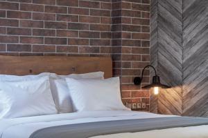 מיטה או מיטות בחדר ב-18 Micon Str.
