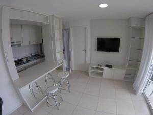 A television and/or entertainment centre at Studio Iracema