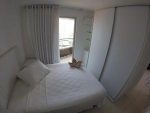 A bed or beds in a room at Studio Iracema