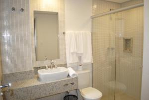 Um banheiro em Hotel Lugus