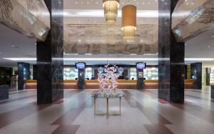 Лобби или стойка регистрации в Park Inn by Radisson Pribaltiyskaya Hotel and Congress Centre