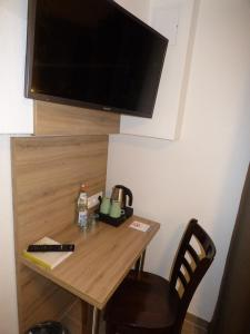 A television and/or entertainment center at Hotel Art Inn Dinslaken