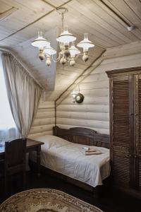 Кровать или кровати в номере Отельный Комплекс Купеческая Усадьба