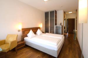Letto o letti in una camera di Hotel Penz West