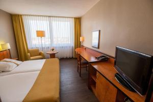 Телевизор и/или развлекательный центр в Best Western Plus Hotel Bautzen
