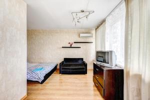 Кровать или кровати в номере Апартаменты на Ленинградском проспекте 33А