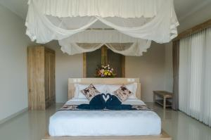 A bed or beds in a room at Villa Maha