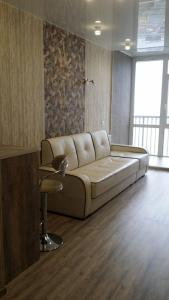 A seating area at Apartamenty na Tigrovoi 16A