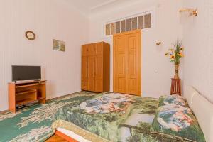 Кровать или кровати в номере 1 Room Apartment on Chaykovskogo